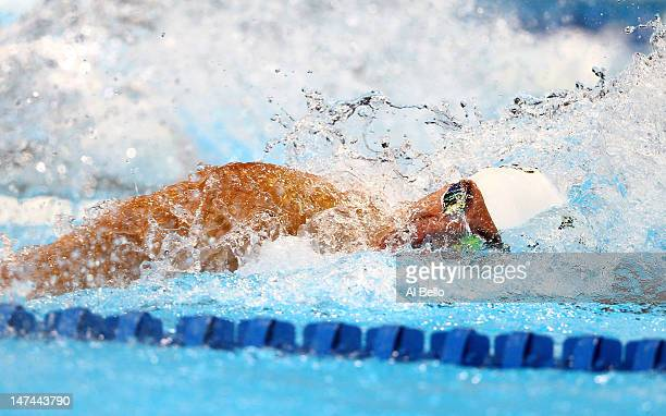 Nathan Adrian competes in the championship final of the Men's 100 m Freestyle during Day Five of the 2012 US Olympic Swimming Team Trials at...