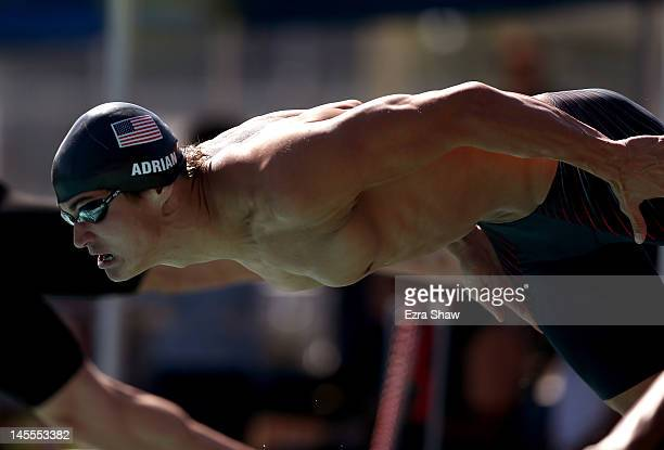 Nathan Adrian dives in at the start of the men's 100 freestyle during day 2 of the Santa Clara International Grand Prix at George F Haines...