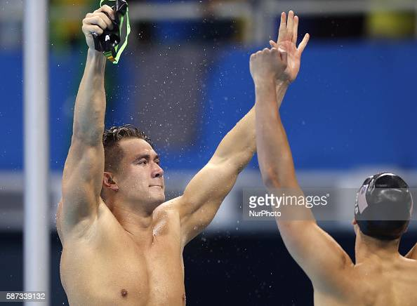 Nathan Adrian from the United States of America and his temmate celebrate after the swimming final of men's 4x100m freestyle relay at the 2016 Rio...