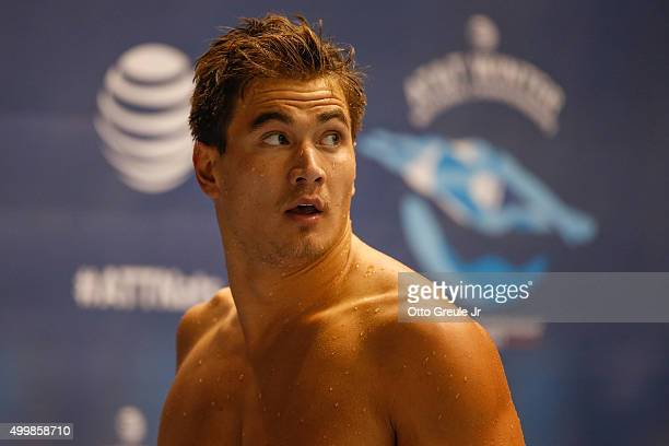 Nathan Adrian looks at the results after swimming the 50 Meter Freestyle preliminary race during the ATT Winter National Championships at the...