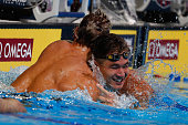 Nathan Adrian of the United States celebrates with Caeleb Dressel of the United States after winning the final heat for the Men's 100 Meter Freestyle...