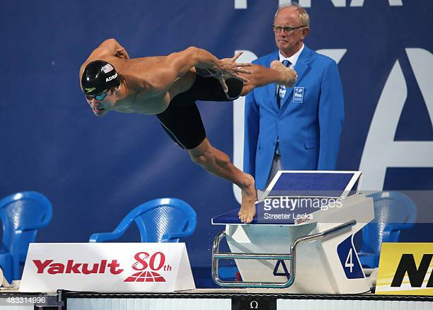 Nathan Adrian of the United States dives in to start the Men's 50m Freestyle semifinal on day fourteen of the 16th FINA World Championships at the...