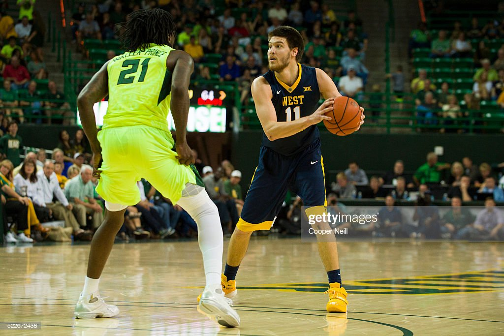 Nathan Adrian of the West Virginia Mountaineers brings the ball up court against the Baylor Bears on March 5 2016 at the Ferrell Center in Waco Texas