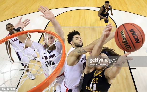 Nathan Adrian of the West Virginia Mountaineers goes up against Josh Perkins of the Gonzaga Bulldogs during the 2017 NCAA Men's Basketball Tournament...