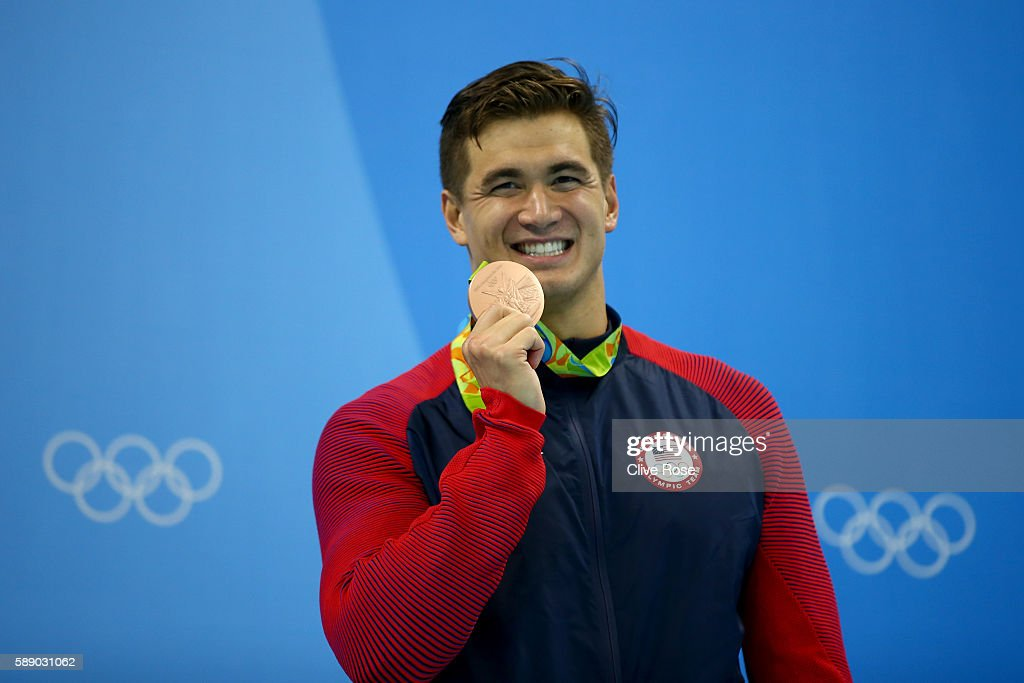 Nathan Adrian of United States celebrates on the podium during the medal ceremony in the Men's 50m Freestyle Final on Day 7 of the Rio 2016 Olympic Games at the Olympic Aquatics Stadium on August 12, 2016 in Rio de Janeiro, Brazil.