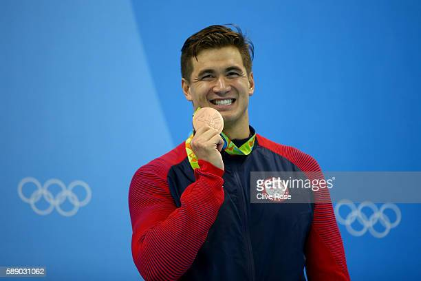 Nathan Adrian of United States celebrates on the podium during the medal ceremony in the Men's 50m Freestyle Final on Day 7 of the Rio 2016 Olympic...