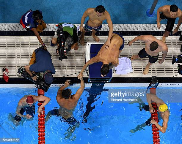 Nathan Adrian Ryan Murphy Michael Phelps and Cody Miller of the United States celebrate winning gold in the Men's 4 x 100m Medley Relay Final on Day...
