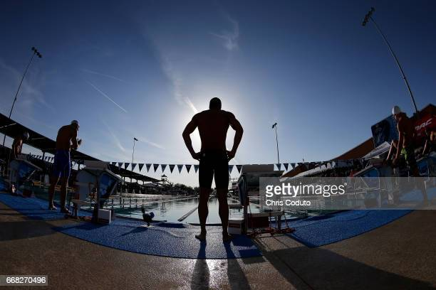 Nathan Adrian waits for the start of the final of the 100 meter freestyle on day one of the Arena Pro Swim Series Mesa at Skyline Aquatic Center on...