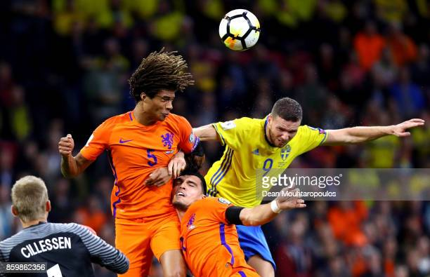 Nathan Ake and Karim Rekik of Netherlands clash with Marcus Berg of Sweden during the FIFA 2018 World Cup Qualifier between Netherlands and Sweden at...