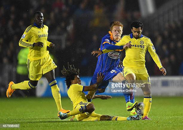 Nathan Ake and Mohamed Salah of Chelsea close down Ryan Woods of Shrewsbury Town during the Capital One Cup Fourth Round match between Shrewsbury...