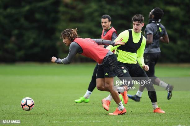 Nathan Ake and Thibaut Courtois of Chelsea during a training session at Chelsea Training Ground on March 10 2017 in Cobham England