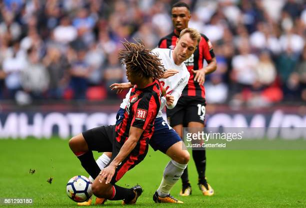Nathan Ake of AFC Bournemouth and Christian Eriksen of Tottenham Hotspur compete for the ball during the Premier League match between Tottenham...
