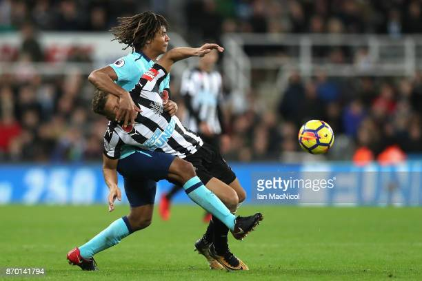 Nathan Ake of AFC Bournemouth and Dwight Gayle in action during the Premier League match between Newcastle United and AFC Bournemouth at St James...