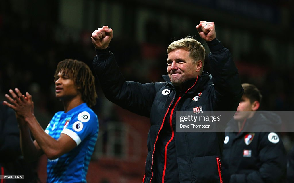 Nathan Ake of AFC Bournemouth (L) and Eddie Howe, Manager of AFC Bournemouth (R) celebrate after the final whistle during the Premier League match between Stoke City and AFC Bournemouth at Bet365 Stadium on November 19, 2016 in Stoke on Trent, England.
