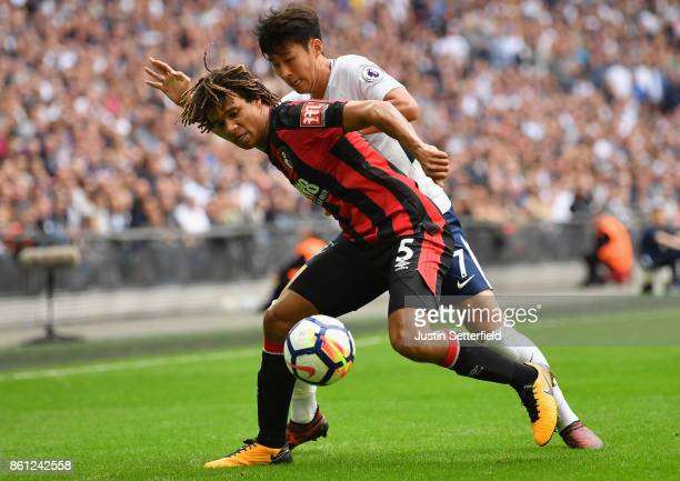 Nathan Ake of AFC Bournemouth and HeungMin Son of Tottenham Hotspur battle for possession during the Premier League match between Tottenham Hotspur...