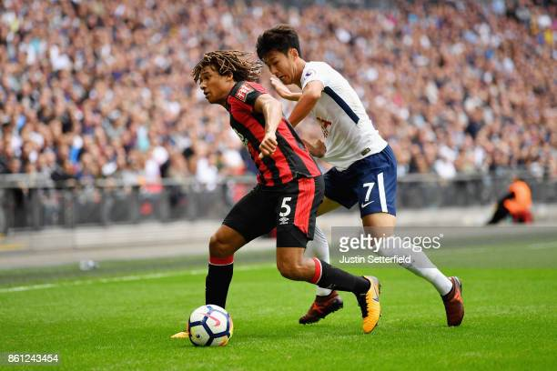 Nathan Ake of AFC Bournemouth and HeungMin Son of Tottenham Hotspur compete for the ball during the Premier League match between Tottenham Hotspur...