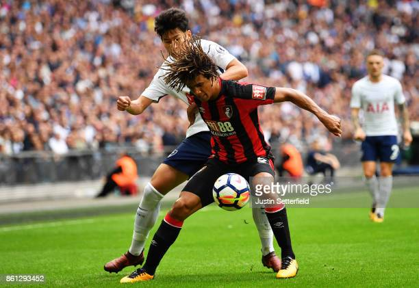 Nathan Ake of AFC Bournemouth and HeungMin Son of Tottenham Hotspur during the Premier League match between Tottenham Hotspur and AFC Bournemouth at...
