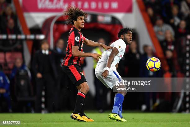 Nathan Ake of AFC Bournemouth and Michy Batshuayi of Chelsea battle for possession during the Premier League match between AFC Bournemouth and...