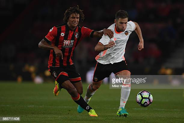 Nathan Ake of Bournemouth challenges Alvaro Medran of Valencia during a preseason friendly between Bournemouth and Valencia at the Vitality Stadium...