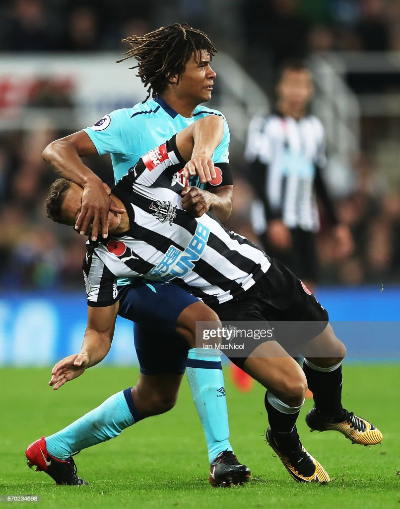 Nathan Ake of Bournemouth vies with Dwight Gayle of Newcastle United during the Premier League match between Newcastle United and AFC Bournemouth at St. James Park on November 4, 2017 in Newcastle upon Tyne, England.