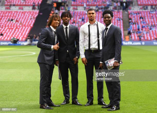 Nathan Ake of Chelsea Diego Costa of Chelsea Ruben LoftusCheek of Chelsea and Ola Aina of Chelsea all take a look around the pitch prior to the...