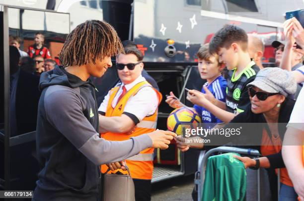 Nathan Ake of Chelsea signs autographs as he arrives at the stadium prior to the Premier League match between AFC Bournemouth and Chelsea at Vitality...