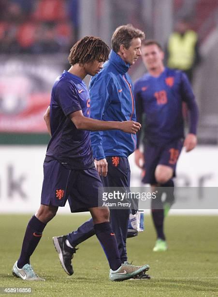 Nathan Ake of the Netherlands goes off injured during the U21 Germany v U21 Netherlands International Friendly match at Audi Sportpark on November 13...