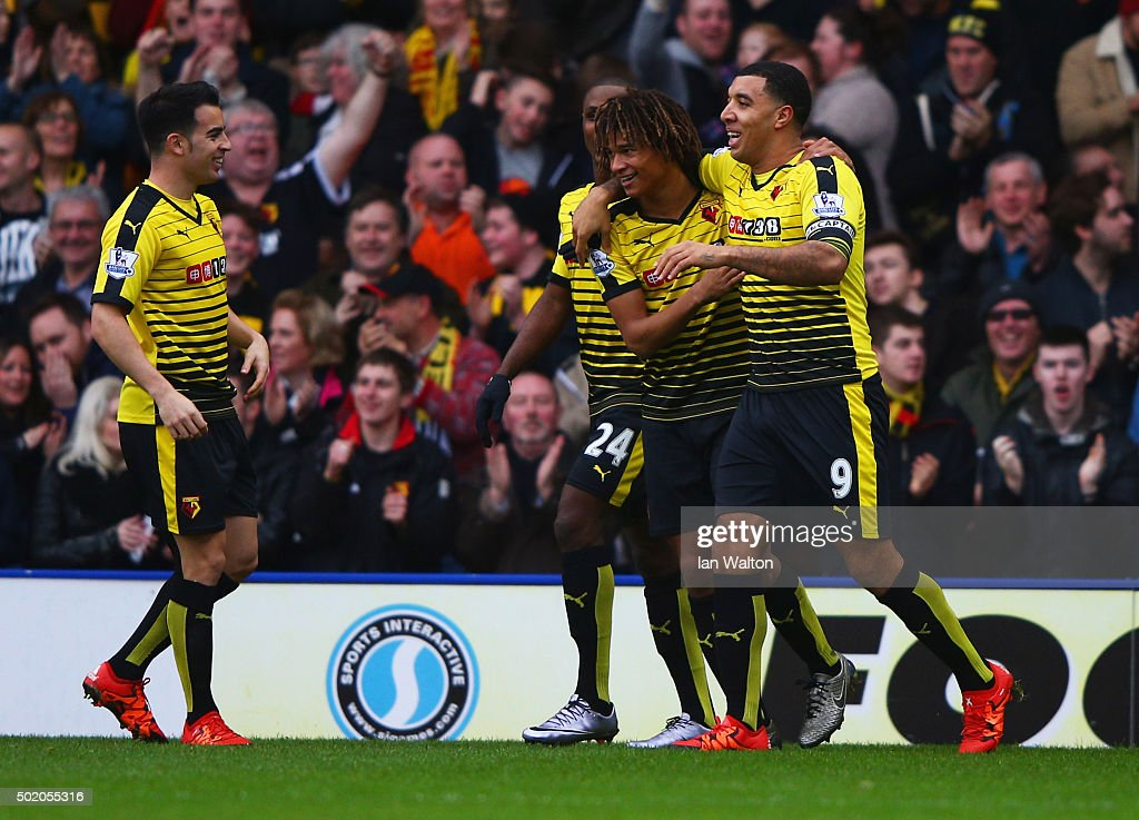 Nathan Ake of Watford celebrates with Troy Deeney and team mates as he scores their first goal during the Barclays Premier League match between...