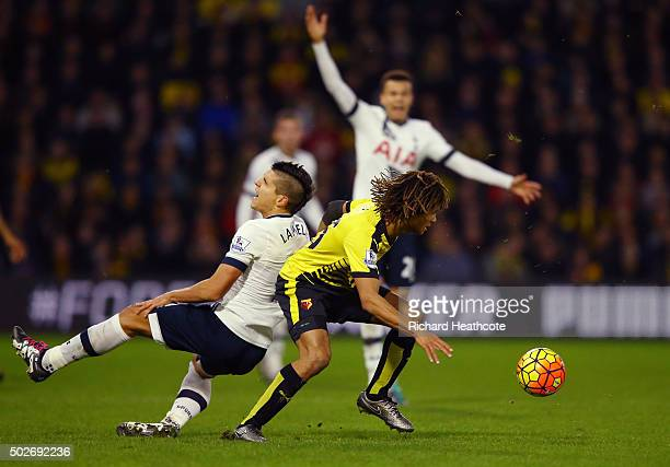 Nathan Ake of Watford fouls Erik Lamela of Tottenham Hotspur resulting in a red card during the Barclays Premier League match between Watford and...