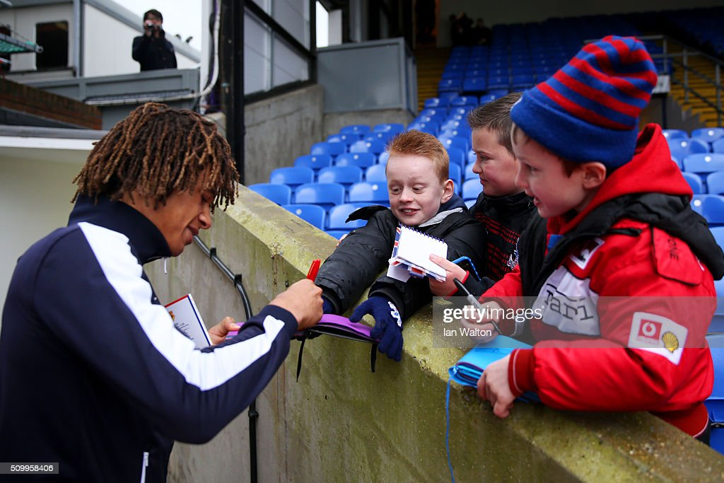 Nathan Ake of Watford signs autographs for young fans on arrival at the stadium prior to the Barclays Premier League match between Crystal Palace and Watford at Selhurst Park on February 13, 2016 in London, England.