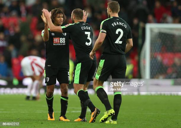 Nathan Ake Steve Cook and Simon Francis of AFC Bournemouth celebrate after the Premier League match between Stoke City and AFC Bournemouth at Bet365...