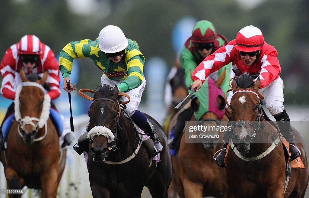Nathan Alison riding Almanack (red) win The Irish Night Apprentice Handicap Stakes at Kempton Park racecourse on July 02, 2014 in Sunbury, England.