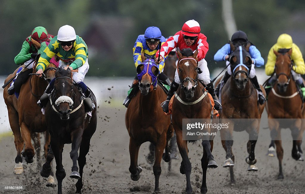 Nathan Alison riding Almanack (3R, red) win The Irish Night Apprentice Handicap Stakes at Kempton Park racecourse on July 02, 2014 in Sunbury, England.