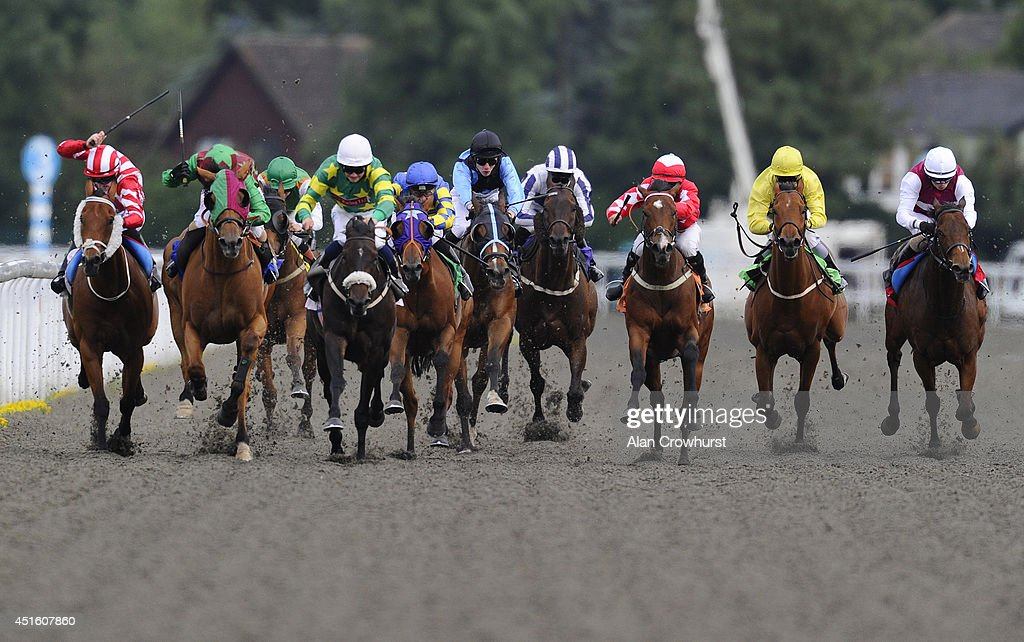 Nathan Alison riding Almanack (3R, red) win The Irish Night Apprentice Handicap Stakes at Kempton Park racecourse on July 02, 2014 in Sunbury, England.