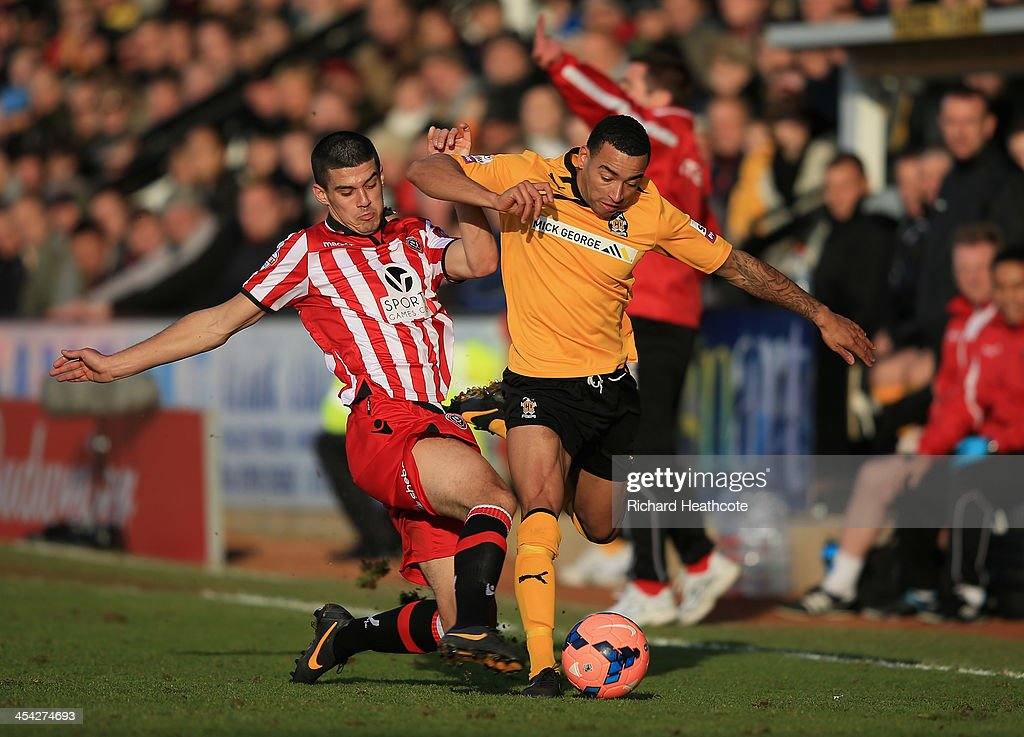 Nathan Arnold of Cambridge is tackled by Conor Coady of Sheffield during the FA Cup Second Round match between Cambridge United and Sheffield United at the Abbey Stadium on December 8, 2013 in Cambridge, Cambridgeshire.