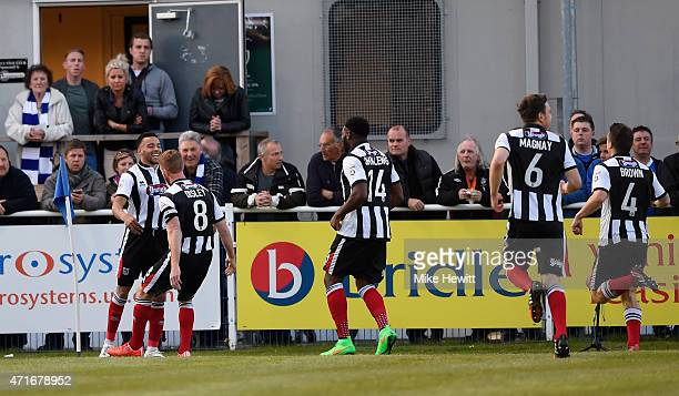 Nathan Arnold of Grimsby celebrates with team mates after scoring during the Vanarama Football Conference League play off 1st leg match between...
