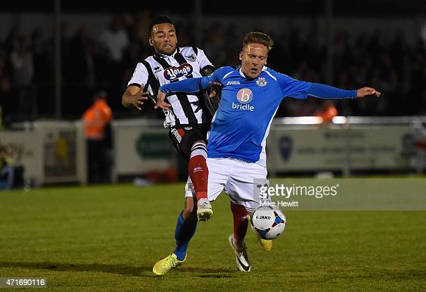 Nathan Arnold of Grimsby fouls Brian Howard of Eastleigh during the Vanarama Football Conference League play off 1st leg match between Eastleigh FC...