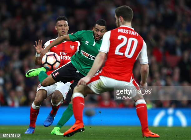 Nathan Arnold of Lincoln City beats Kieran Gibbs and Shkodran Mustafi of Arsenal to shot on goal during The Emirates FA Cup QuarterFinal match...