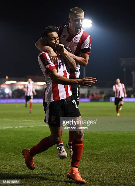 Nathan Arnold of Lincoln City celebrates scoring his sides first goal with his Lincoln team mates during the Emirates FA Cup third round replay...