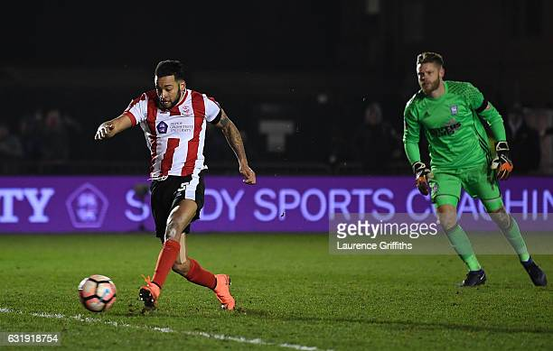 Nathan Arnold of Lincoln City takes the ball around Dean Gerken of Ipswich Town and goes on to score during the Emirates FA Cup third round replay...
