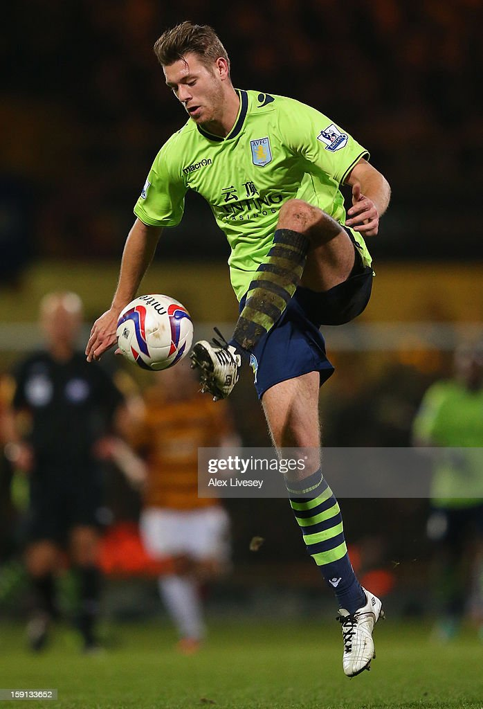 Nathan Baker of Aston Villa controls the ball during the Capital One Cup Semi-Final 1st Leg match between Bradford City and Aston Villa at Coral Windows Stadium, Valley Parade on January 8, 2013 in Bradford, England.
