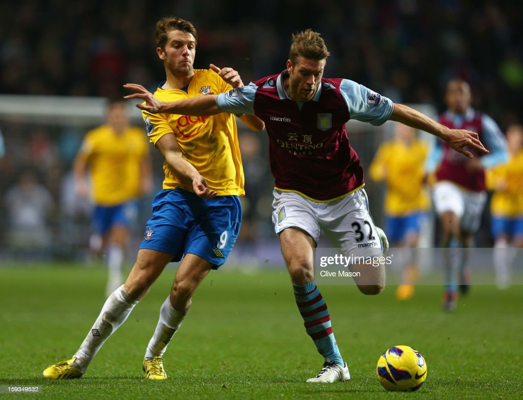Nathan Baker of Aston Villa holds off a challenge from Jay Rodriguez of Southampton during the Barclays Premier League match between Aston Villa and Southampton at Villa Park on January 12, 2013 in Birmingham, England.
