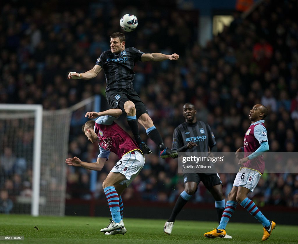 Nathan Baker of Aston Villa is challenged by <a gi-track='captionPersonalityLinkClicked' href=/galleries/search?phrase=James+Milner+-+Soccer+Player&family=editorial&specificpeople=214576 ng-click='$event.stopPropagation()'>James Milner</a> of Manchester City during the Barclays Premier League match between Aston Villa and Manchester City at Villa Park on March 04, 2013 in Birmingham, England.