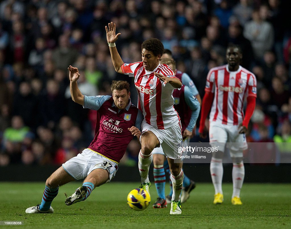 Nathan Baker of Aston Villa is challenged by Ryan Shotton of Stoke City during the Barclays Premier League match between Aston Villa and Stoke City at Villa Park on December 08, 2012 in Birmingham, England.