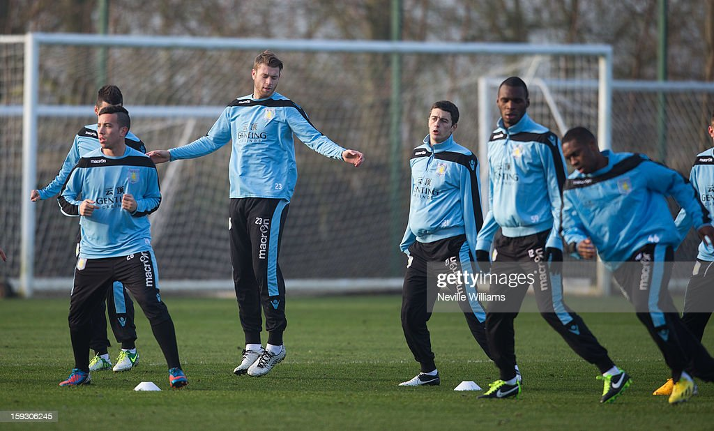 Nathan Baker of Aston Villa trains with team mates during a Aston Villa training session at the club's training ground at Bodymoor Heath on January 11, 2013 in Birmingham, England.