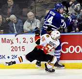 Nathan Bastian of the Mississauga Steelheads and Adam Bignell of the Belleville Bulls collide on the boards during OHL game action on January 16 2015...