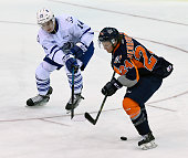 Nathan Bastian of the Mississauga Steelheads and Mathieu Henderson of the Flint Firebirds battle for the puck during OHL game action on October 4...
