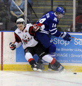 Nathan Bastian of the Mississauga Steelheads bangs into Blake Siebenaler of the Niagara Icedogs during game action on March 14 2014 at the Hershey...