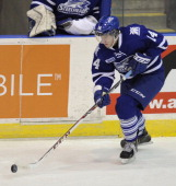 Nathan Bastian of the Mississauga Steelheads controls the puck against the North Bay Battalion during game action on March 7 2014 at the Hershey...