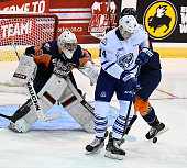Nathan Bastian of the Mississauga Steelheads looks for a rebound in front of goalie Kyle Keyser of the Flint Firebirds during OHL game action on...